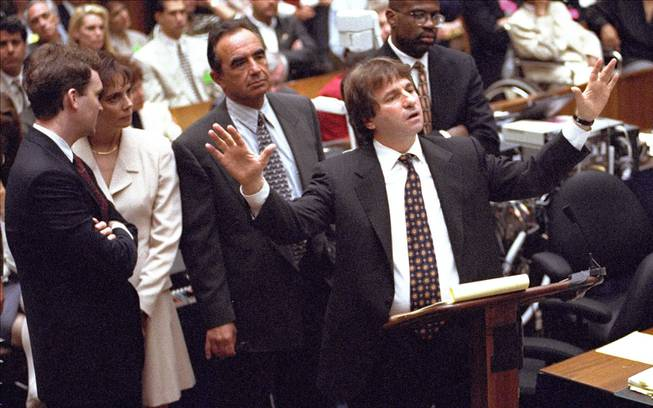 In this Sept. 15, 1995, file photo, defense attorney Barry Scheck, center, cross examines prosecution witness William Bodziak as, from left, Hank Goldberg, Marcia Clark, Robert Shapiro, and Christopher Darden look on during the O.J. Simpson double-murder trial in Los Angeles. Scheck, the lawyer who introduced the science of DNA to jurors and to the public watching the trial on TV, attacked police methods of evidence collection and demolished the prosecution's forensic evidence case.