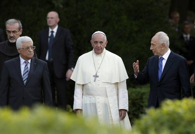 Pope Francis, Israel's President Shimon Peres, right, and Palestinian President Mahmoud Abbas, left, pray for peace at the Vatican on Sunday, June 8, 2014. Pope Francis waded head-first into Mideast peace-making Sunday, welcoming the Israeli and Palestinian presidents to the Vatican for an evening of peace prayers just weeks after the last round of U.S.-sponsored negotiations collapsed.