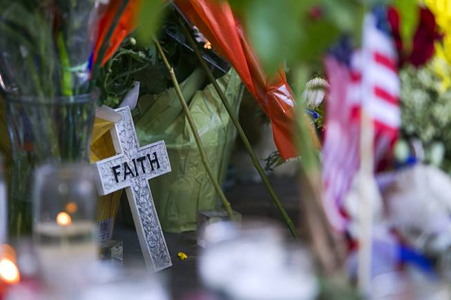 A memorial is shown in front of CiCi's Pizza, where two Metro Police officers were killed, during a community vigil Monday,, Nevada June 9, 2014. Police officers Alyn Beck, 41, and Igor Soldo, 31, were ambushed and killed in the restaurant while they were eating lunch on June 8.
