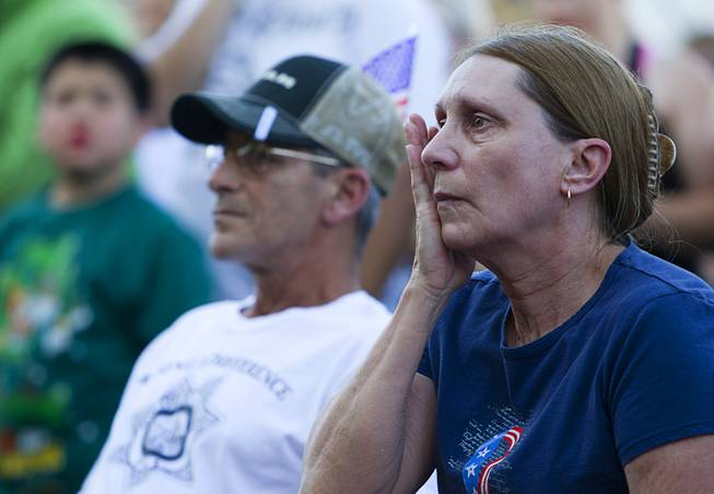 Larry Gold, left, and his wife Deborah attend a community vigil for two slain Metro Police officers at CiCi's Pizza Monday,, Nevada June 9, 2014. Officers Alyn Beck, 41, and Igor Soldo, 31, were ambushed and killed in the restaurant while they were eating lunch on June 8.