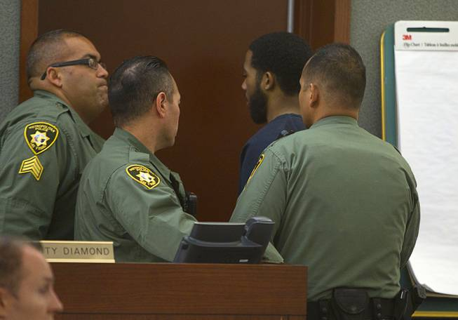 Prentice Marshall leaves the courtroom in at the Regional Justice Center Monday, June 9, 2014. Marshall is one of the men accused of killing Las Vegas police officer Trevor Nettleton in 2009.