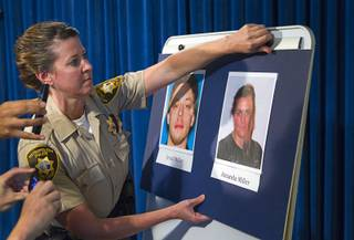 Metro Police Office Laura Meltzer posts photos during a news conference at Metro Police headquarters Monday, June 9, 2014.