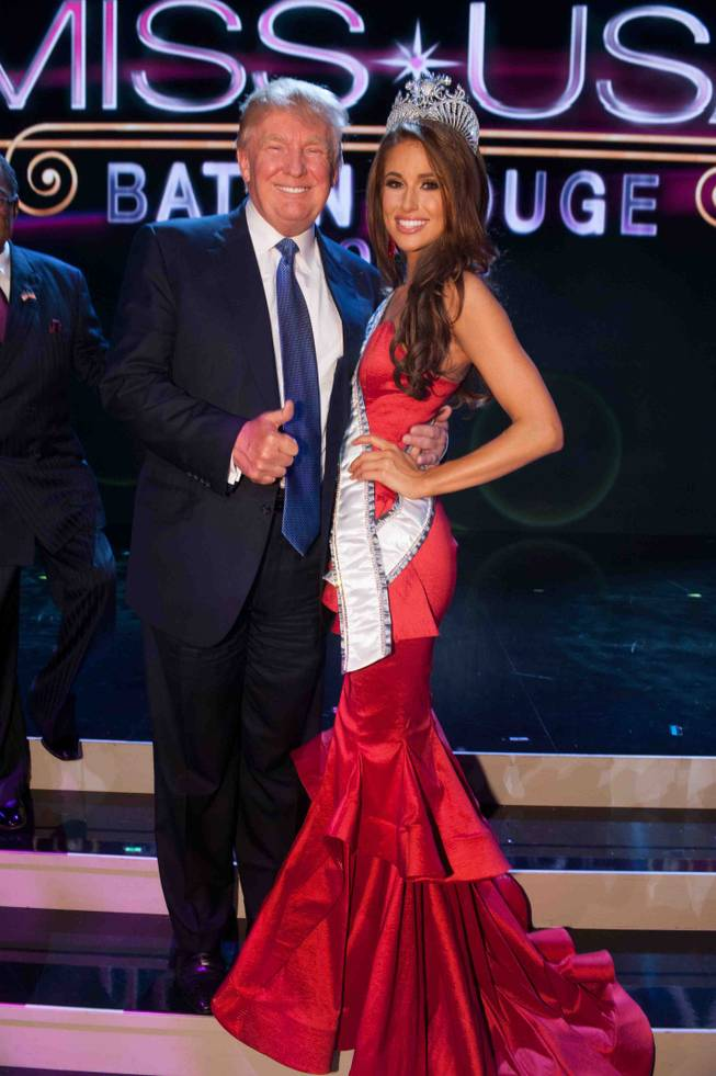 2014 Miss Nevada USA Nia Sanchez, with Donald Trump, is crowned 2014 Miss USA at the 2014 Miss USA Pageant at Baton Rouge River Center on Sunday, June 8, 2014, in Baton Rouge, La.