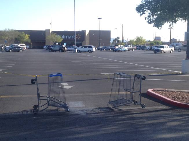 Upturned carts and police tape block a parking lot entrance to a Wal-Mart store at 201 N. Nellis on Monday, June 6, 2014, a day after a shooting that left five people dead, including two Metro Police officers who were shot at a nearby pizza restaurant. One person was shot and killed at the Wal-Mart, where the two shooters also died.