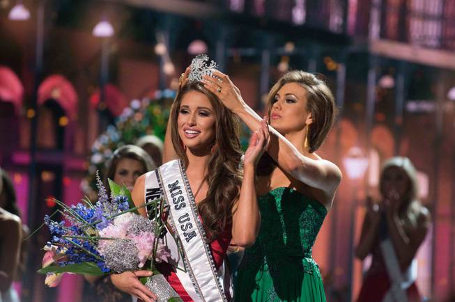 2014 Miss Nevada USA Nia Sanchez is crowned 2014 Miss USA by 2013 Miss USA Erin Brady of Connecticut at the 2014 Miss USA Pageant at Baton Rouge River Center on Sunday, June 8, 2014, in Baton Rouge, La.