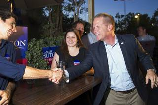 Mark Hutchison, right, Republican candidate for Lt. Governor, greets supporters during an primary election night party at Dom Demarco's Pizzeria Tuesday, June 10, 2014.