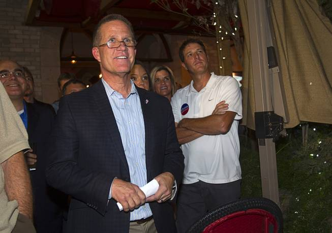 Mark Hutchison, Republican candidate for Lt. Governor, prepares to take the stage during an primary election night party at Dom Demarco's Pizzeria Tuesday, June 10, 2014.