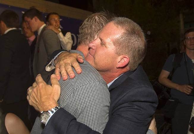 Mark Hutchison, right, Republican candidate for Lt. Governor, gets a hug from David McKeon, chairman of the Clark County Republican Party, during an primary election night party at Dom Demarco's Pizzeria Tuesday, June 10, 2014.