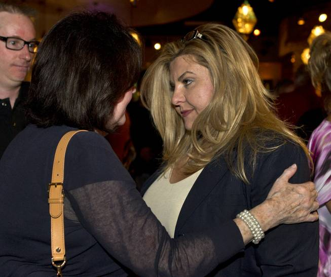 Assemblywoman Michele Fiore  is congratulated by Sue Lowden's  executive assistant Chris Hall as her race is going well during a Republican gathering at Mundo restaurant on Monday, June 9, 2014.