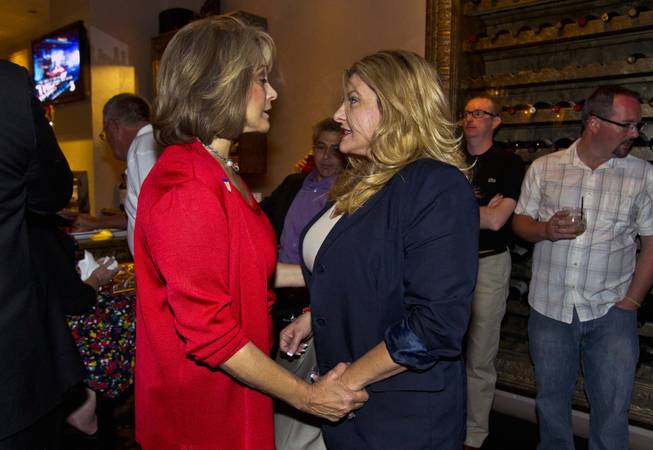 Lieutenant Governor candidate Sue Lowden shares a few words with Assemblywoman Michele Fiore as Republicans gather at Mundo restaurant on Monday, June 9, 2014.