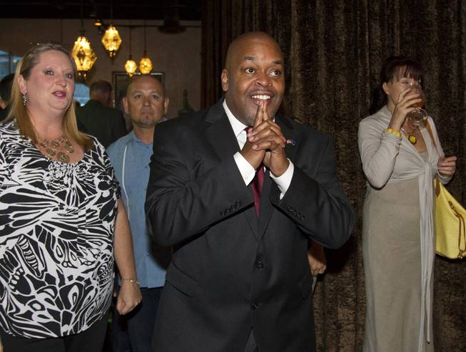 Congressional candidate Niger Innis for the 4th District, is pleased with the election results so far while Republicans are gathered at Mundo restaurant on Monday, June 9, 2014.