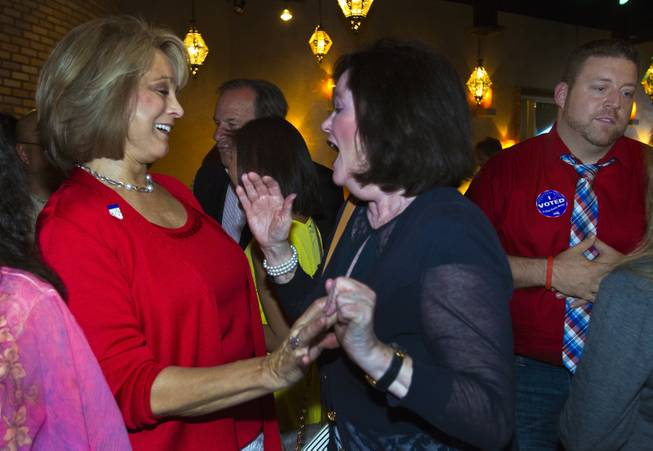 Lieutenant Governor candidate Sue Lowden shares a few words with a supporter as Republicans gather at Mundo restaurant on Monday, June 9, 2014.