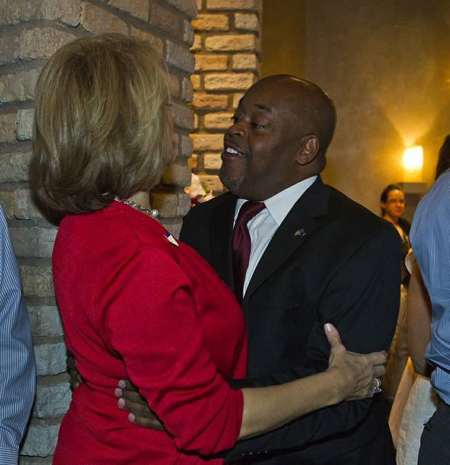 Lieutenant governor candidate Sue Lowden greets Congressional candidate Niger Innis for the 4th District as Republicans are gathered at Mundo restaurant on Monday, June 9, 2014.