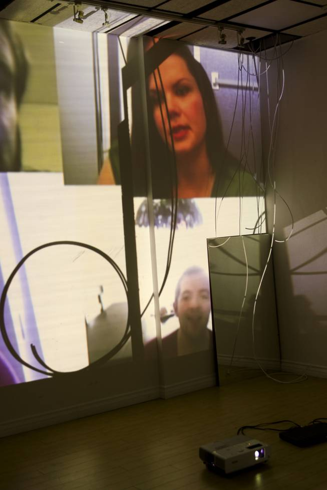 "The video installation portion at TastySpace Gallery of the ""Derivative Presence"" exhibit by artist Yasmina Chavez and Javier Sanchez Monday, May 9, 2014."