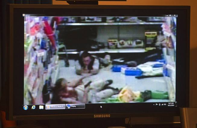 Wal-Mart store surveillance video of shooting suspects is shown during a news conference at Metro Police headquarters Wednesday, June 11, 2014. Police provided new details on Sunday's shooting that resulted in five deaths, including two police officers and a civilian.