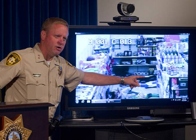 Assistant Sheriff Kevin McMahill points to Wal-Mart store surveillance video of shooting suspects during a news conference at Metro Police headquarters Wednesday, June 11, 2014. Police provided new details on Sunday's shooting that resulted in five deaths, including two police officers and a civilian.