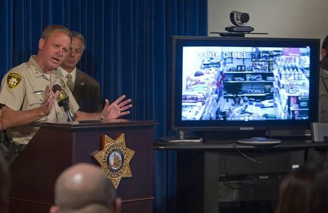 Assistant Sheriff Kevin McMahill speaks as Wal-Mart store surveillance video of shooting suspects is shown during a news conference at Metro Police headquarters Wednesday, June 11, 2014. Police provided new details on Sunday's shooting that resulted in five deaths, including two police officers and a civilian.