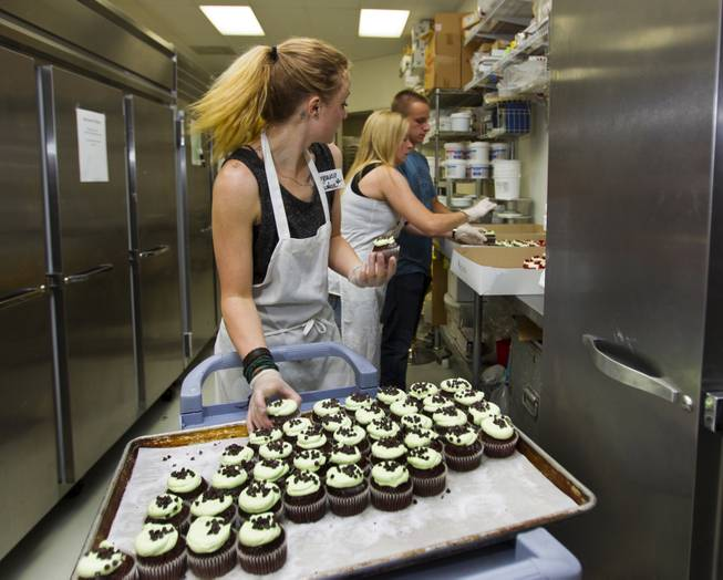 Workers and volunteers at Freed's Bakery of Las Vegas box up a few of the 35,000 cupcakes sold for $1 each with the proceeds going to aid the families of slain Metro Police Officers Alyn Beck and Igor Soldo on Wednesday, June 11, 2014.