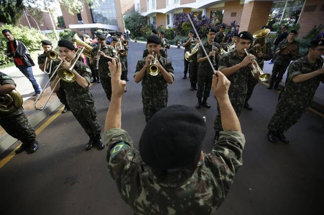 Brazilian military band performs South Korea's national anthem before the national soccer team's arrival at the team hotel in Foz do Iguacu, Brazil, Wednesday, June 11, 2014. South Korea play in group H of the 2014 soccer World Cup.