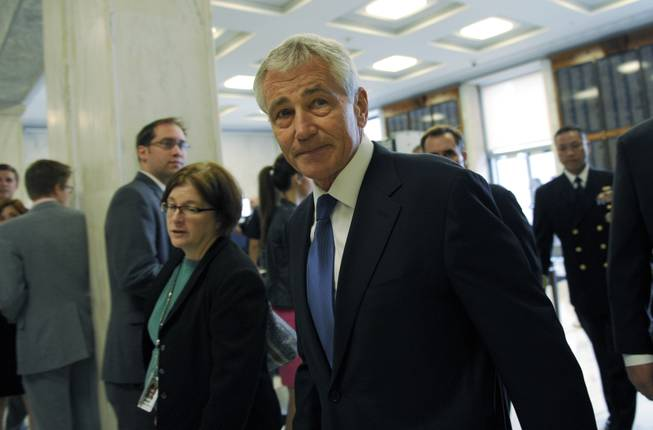 Defense Secretary Chuck Hagel arrives on Capitol Hill in Washington, Wednesday, June 11, 2014, to testify before the House Armed Services Committee.