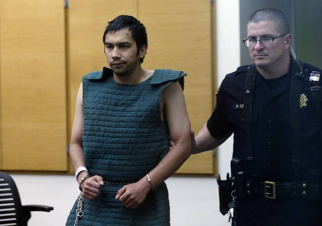 In this Friday, June 6, 2014, file photo, shooting suspect Aaron Ybarra, left, is led in chains to a court hearing at a King County Jail courtroom Friday, June 6, 2014, in Seattle, as he was arrested in the fatal shooting of a 19-year-old student and wounding of two other young people a day earlier at Seattle Pacific University. At a time when shootings seem to happen almost daily, how should Americans react if someone opens fire at work, at school or at a theater or store?
