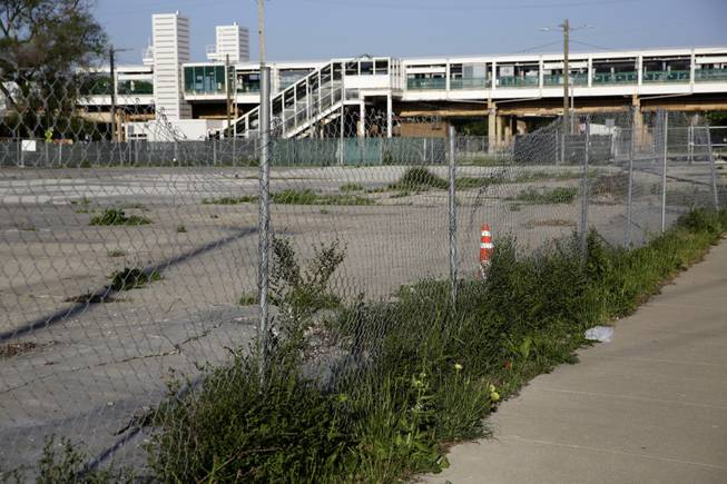 Several empty lots on the corner of 55th Street and Dr. Martin Luther King, Jr. Drive between Washington Park and the CTA Green Line Garfield Station, seen, June 3, 2014, is one of three proposed locations for the Obama Presidential Library.