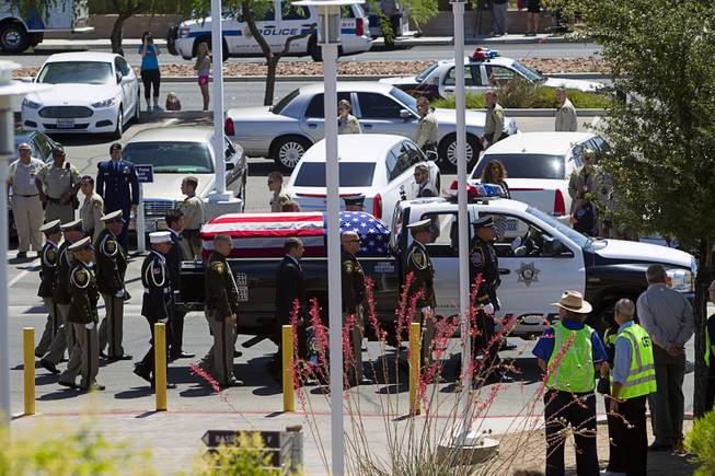 A truck with the casket containing Metro Police officer Igor Soldo arrives for funeral services at Canyon Ridge Church Thursday, June 12, 2014. Soldo and Metro Police Officer Alyn Beck where ambushed and killed by Jerad and Amanda Miller while eating lunch on Sunday, June 8.