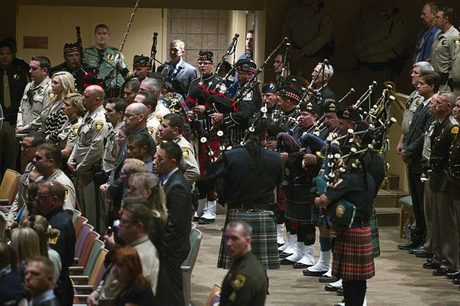 Members of the Las Vegas Firefighters Pipe & Drum Band and Honor Guard perform during services for Metro Police officer Igor Soldo at Canyon Ridge Church Thursday, June 12, 2014. Soldo and Metro Police Officer Alyn Beck where ambushed and killed by Jerad and Amanda Miller while eating lunch on Sunday, June 8.