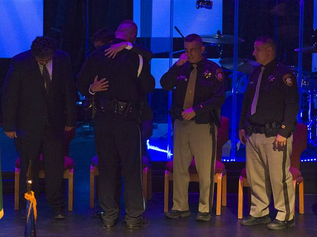 Robert Soldo, the older brother of Metro Police officer Igor Soldo, gets a hug from his brother's friends, after speaking at his brother's funeral at Canyon Ridge Church Thursday, June 12, 2014. Igor Soldo and Metro Police Officer Alyn Beck where ambushed and killed by Jerad and Amanda Miller while eating lunch on Sunday, June 8.