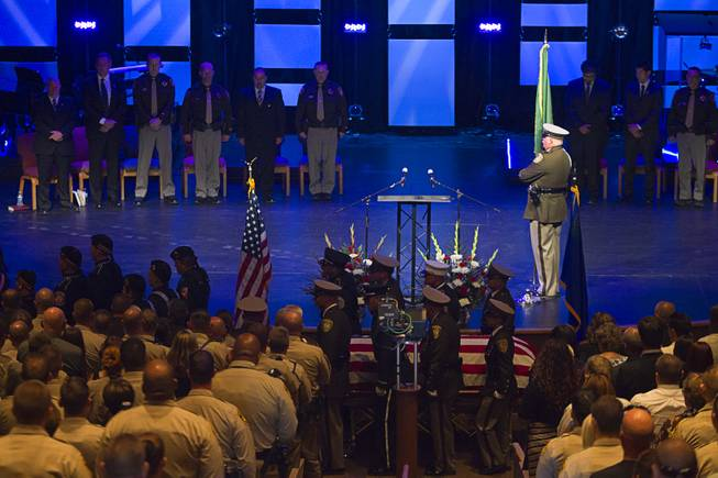 An honor guard carries the casket of Metro Police officer Igor Soldo following a funeral service at Canyon Ridge Church Thursday, June 12, 2014. Soldo and Metro Police Officer Alyn Beck where ambushed and killed by Jerad and Amanda Miller while eating lunch on Sunday, June 8.