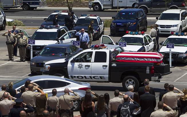 A truck with the casket of Metro Police officer Igor Soldo leaves for Palm Mortuary following a funeral service at Canyon Ridge Church Thursday, June 12, 2014. Soldo and Metro Police Officer Alyn Beck where ambushed and killed by Jerad and Amanda Miller while eating lunch on Sunday, June 8.