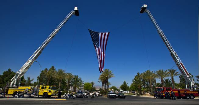 Metro Police Motorcycle Officers lead a funeral procession for slain Metro Officer Igor Soldo as it departs from the Palm Mortuary to the Canyon Ridge Church service on Thursday, June 12, 2014.