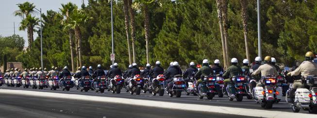 Metro Police Motorcycle Officers and other department officers lead a funeral procession for slain Metro Officer Igor Soldo as it departs from the Palm Mortuary to the Canyon Ridge Church service on Thursday, June 12, 2014.