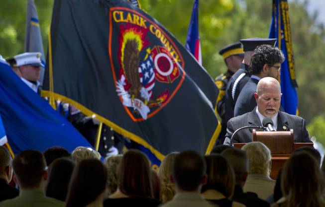 Pastor Dean Sanner speaks during funeral services for slain Metro Officer Igor Soldo at the Palm Mortuary on Thursday, June 12, 2014.