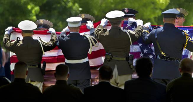 An American flag is folded to be given to Andrea Soldo during funeral services for her husband, slain Metro Officer Igor Soldo, at the Palm Mortuary on Thursday, June 12, 2014.