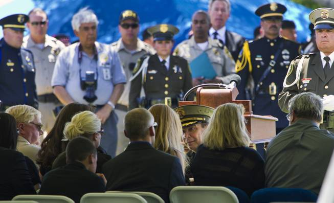 Clark County Sheriff Doug Gillespie presents a folded American flag to Andrea Soldo, the wife of slain Metro Officer Igor Soldo, during funeral services at the Palm Mortuary on Thursday, June 12, 2014.