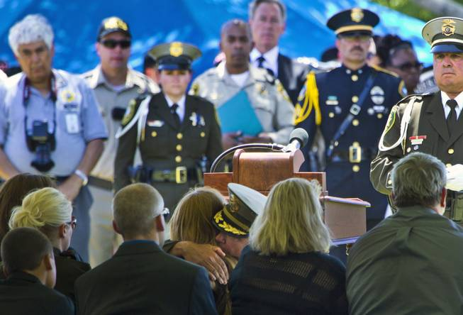 Clark County Sheriff Doug Gillespie hugs Andrea Soldo, the wife of slain Metro Officer Igor Soldo, during funeral services at the Palm Mortuary on Thursday, June 12, 2014.