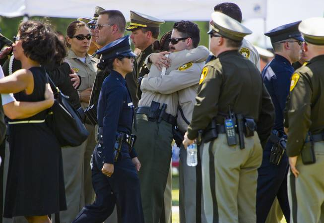 Officers and supporters come together following funeral services for slain Metro Officer Igor Soldo at the Palm Mortuary on Thursday, June 12, 2014.