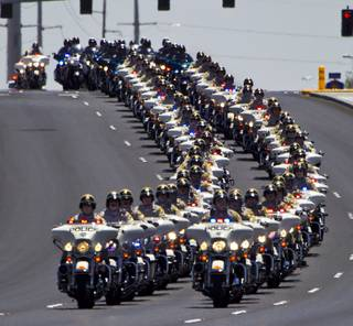 Metro Motorcycle Officers are joined by those from other area departments as they lead the body of slain Metro Officer Igor Soldo to the Palm Mortuary for funeral services on Thursday, June 12, 2014.