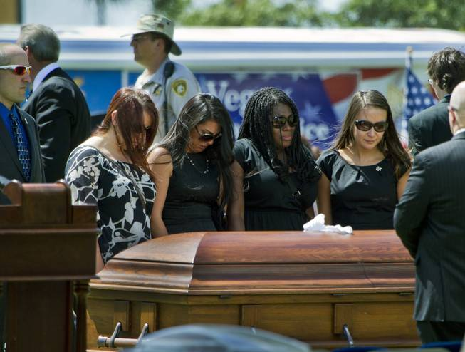 The casket of slain Metro Officer Igor Soldo is visited by those closest to him following funeral services at the Palm Mortuary on Thursday, June 12, 2014.