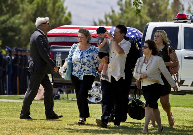 Family members and supporters begin to gather for the funeral services for slain Metro Officer Igor Soldo at the Palm Mortuary on Thursday, June 12, 2014.