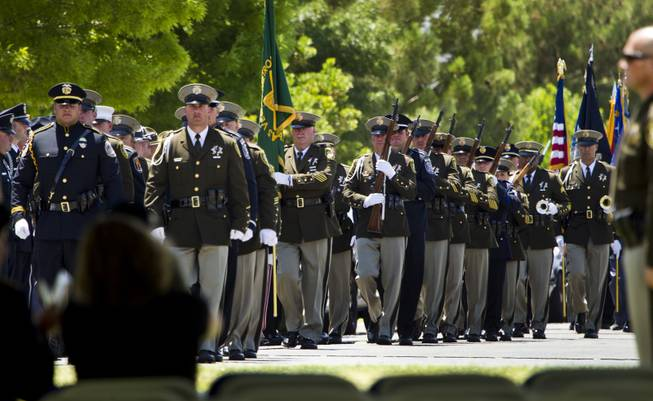 Color guards, rifle detail and buglers march into place during funeral services for slain Metro Officer Igor Soldo at the Palm Mortuary on Thursday, June 12, 2014.