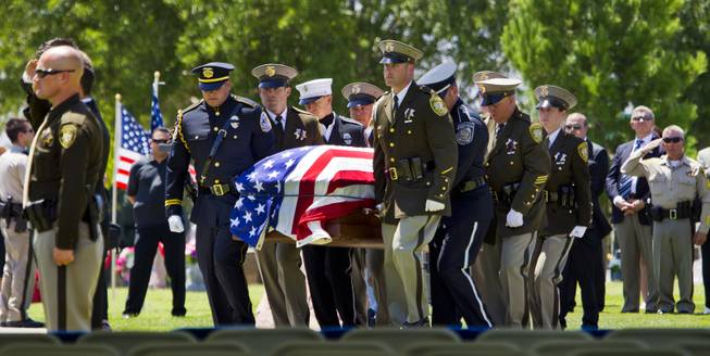 The flag-draped casket of Metro Police Officer Igor Soldo is carried over to begin funeral services at the Palm Mortuary on Thursday, June 12, 2014.
