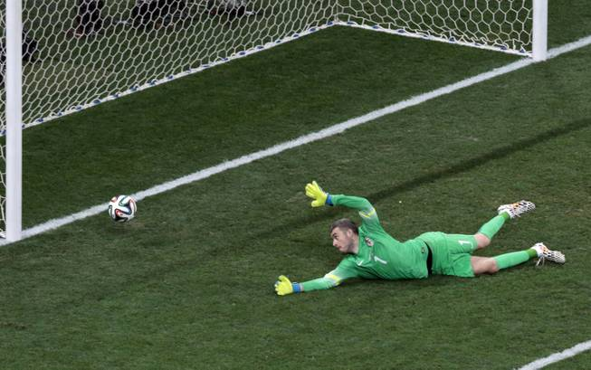 Croatia's goalkeeper Stipe Pletikosa fails to make a safe as Brazil's Oscar scores his side's third goal during the group A World Cup soccer match between Brazil and Croatia, the opening game of the tournament, in the Itaquerao Stadium in Sao Paulo, Brazil, Thursday, June 12, 2014.