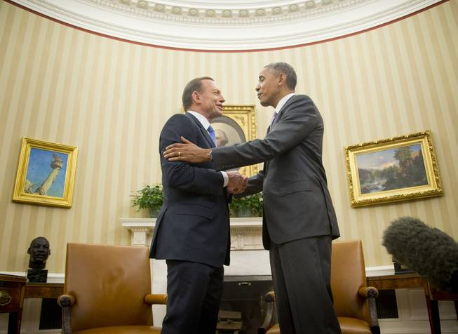 President Barack Obama talks with Australian Prime Minister Tony Abbott, Thursday, June 12, 2014, following their meeting in the Oval Office of the White House in Washington.