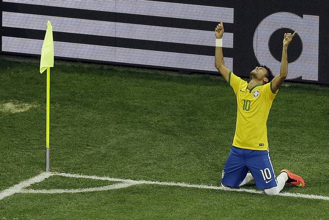 Brazil's Neymar celebrates scoring his side's second goal during the group A World Cup soccer match between Brazil and Croatia, the opening game of the tournament, in Itaquerao Stadium in Sao Paulo, Brazil, on Thursday, June 12, 2014.