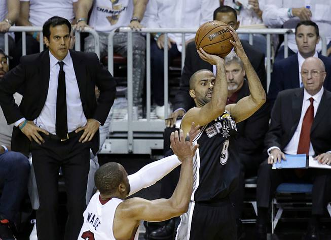 San Antonio Spurs guard Tony Parker (9) shoots against the Miami Heat in the first half in Game 4 of the NBA finals Thursday, June 12, 2014, in Miami.