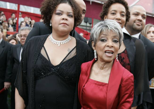 "In this Feb. 24, 2008, file photo, Ruby Dee, right, nominated for an Oscar for best actress in a supporting role for her work in ""American Gangster,"" and a guest arrive for the 80th Academy Awards in Hollywood."
