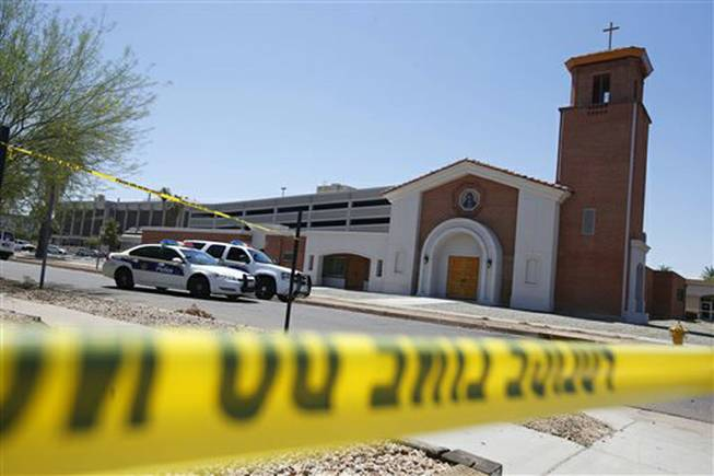 Phoenix police were still on the scene after a Wednesday evening attack left a priest shot and killed and another injured at the Roman Catholic church the Mother of Mercy Mission on Thursday, June 12, 2014, in Phoenix. Police have no suspects at this point, but they are canvassing the neighborhood and going over physical evidence from the scene.