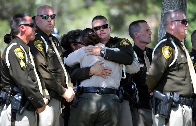 Las Vegas police officers console each during funeral services for Las Vegas police officer Igor Soldo at Palm Northwest Mortuary & Cemetery on Thursday, June 12, 2014 in Las Vegas. Soldo, 31, and fellow officer, Alyn Beck, 41, were gun down by two assailants at a Cici's Pizza during their lunch break Sunday. Services for Beck are scheduled for Saturday.
